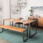 Dining Room With Western Influence Minimalist Dining Furniture Medium & Dark Finishes Medium Tone Console Table With Dark Tone Wood Door Blue Rug Wall Arts Classic Pendant Lamp