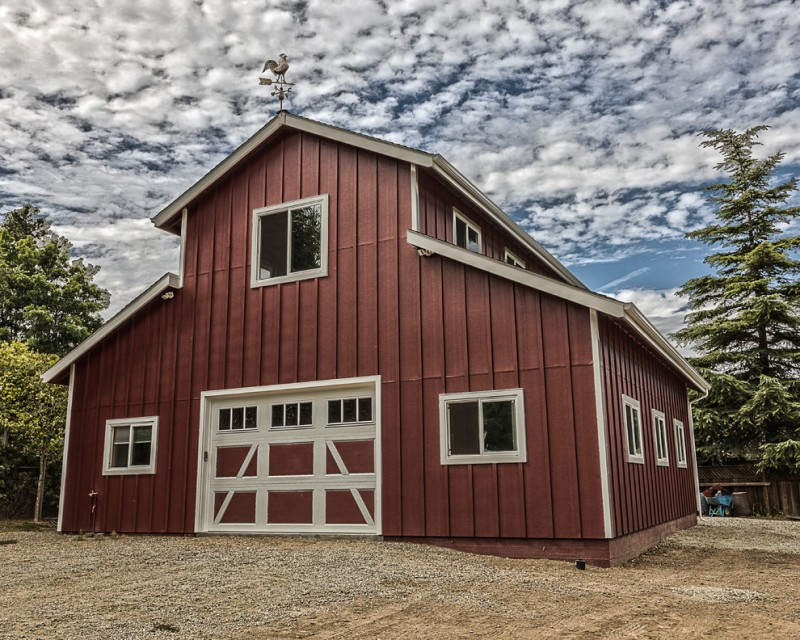 farmhouse shed with white framed garage door and white framed glass window series