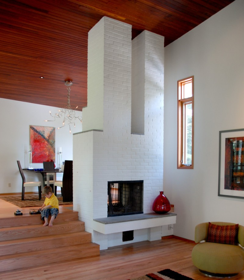 floor to ceiling white brick fireplace in contemporary style
