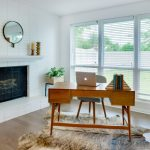 Home Office With Modern White Brick Fireplace Building Modern Retro Wooden Working Desk Cow Hide Mat Modern Circular Mirror