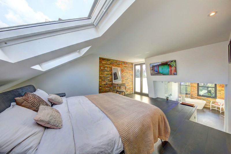 loft conversion idea with blend modern Western style a bed with large skylight on top unique bricks wall systems