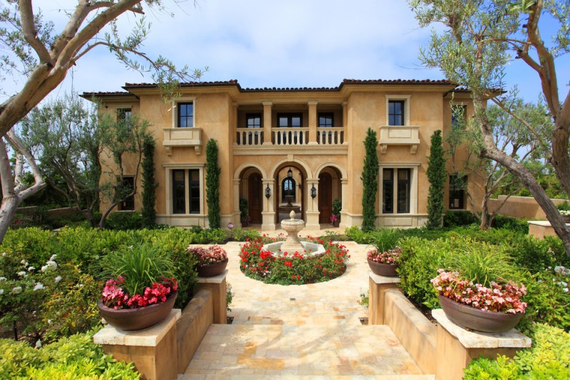 luxurious Tuscan estate with exterior stucco light beige stone floors beautifully green yard