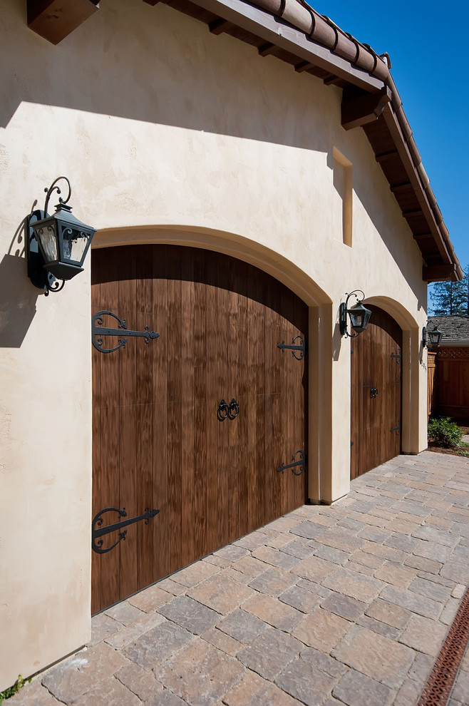 mediterranean garage door with dark iron hinges