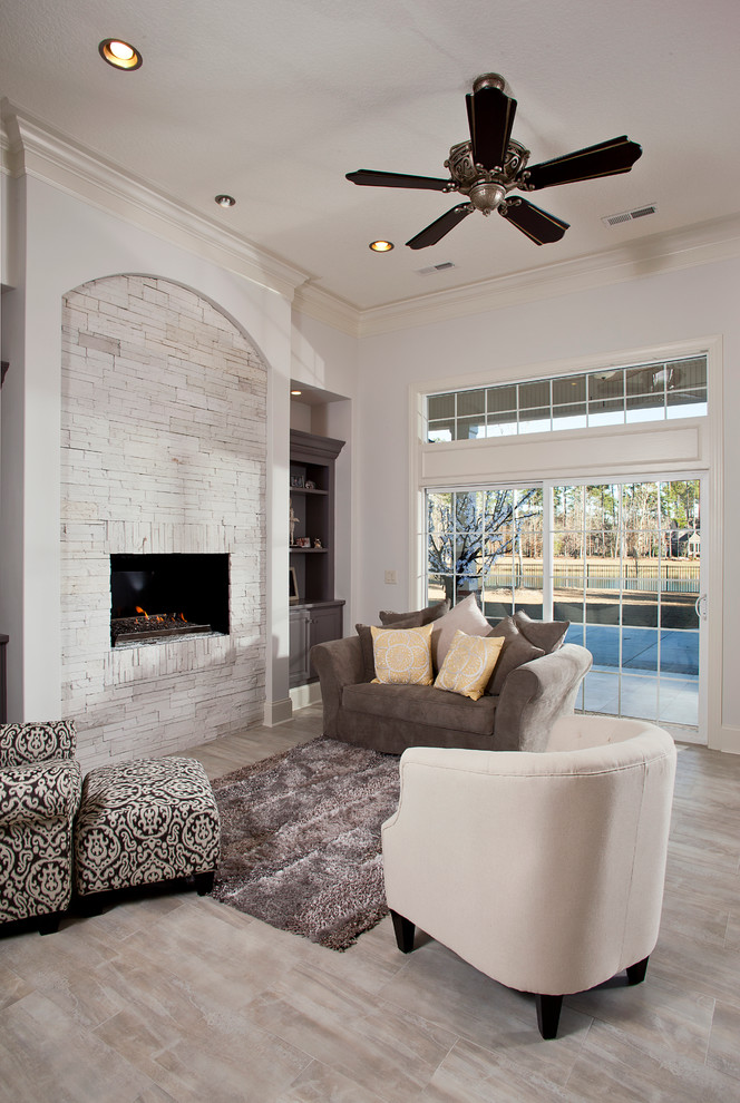 mediterranean white brick fireplace a set of furniture in multicolor dark ceiling fan animal skin rug whitewash floor system