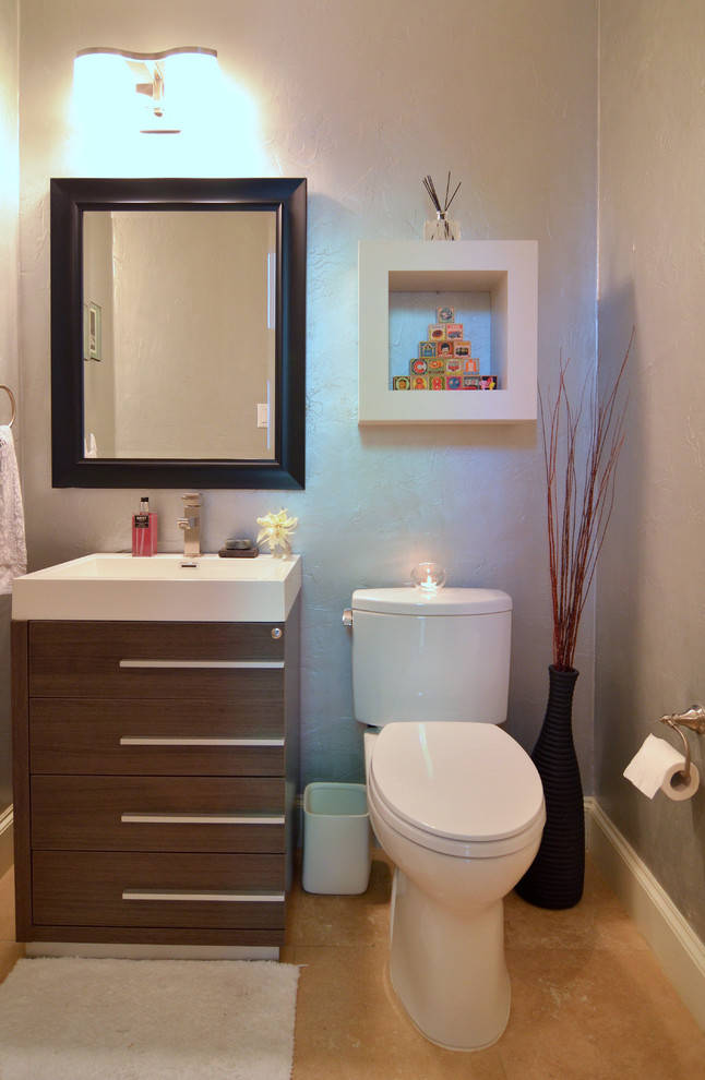 minimalist bathroom vanity with black frame mirror and wall mounted lamp on top