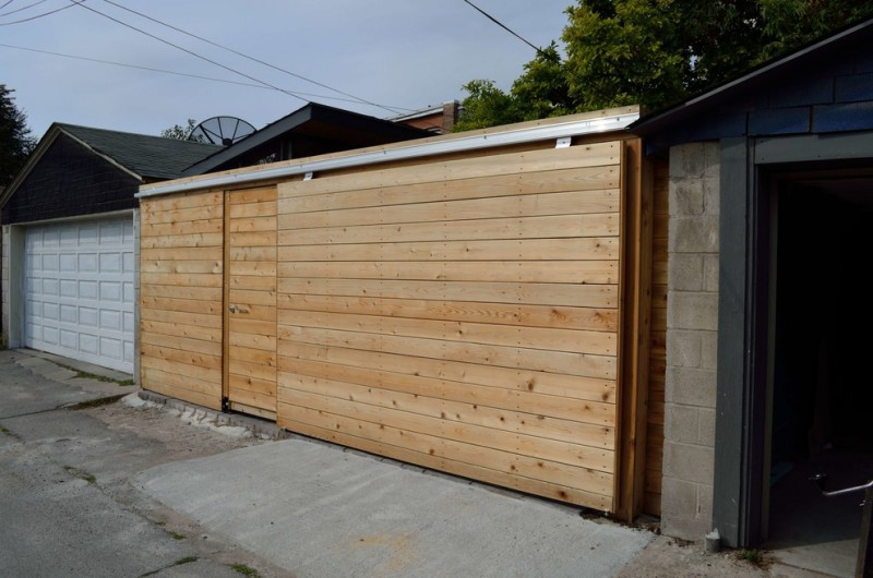 minimalist garage door made of solid wood