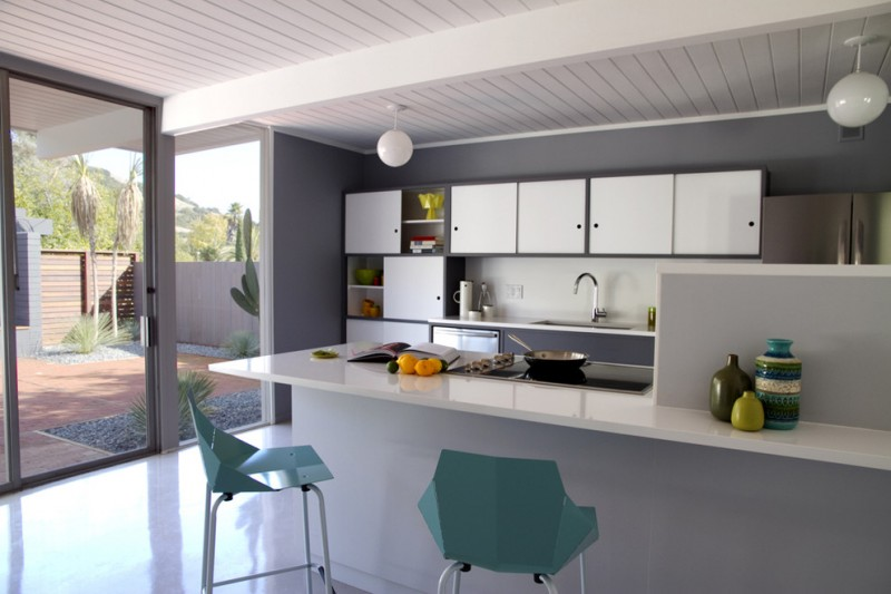 modern minimalist kitchen design with turquoise and white tones twin turquoise bar stools pure white countertop pure white kitchen island white ball shaped pendant lamp white kitchen cabinet system