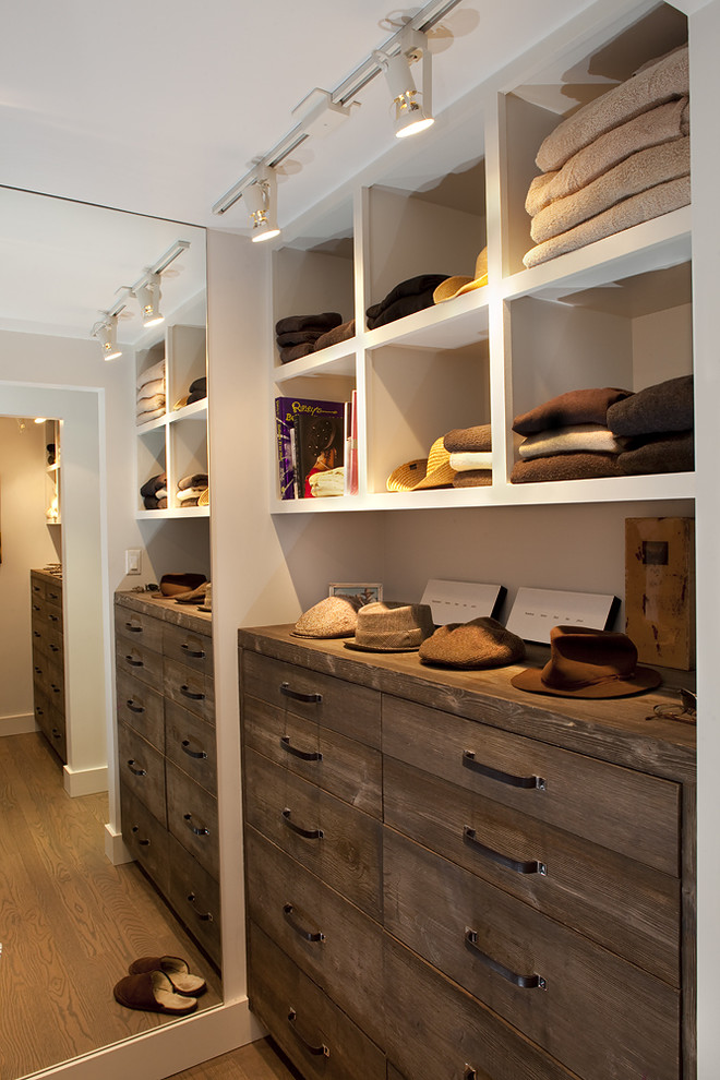 modern rustic walk in closet idea with flat panel drawer system and white open shelves