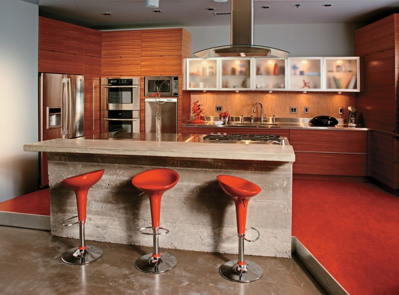 modern scarlet bar stools with rounded metal base cream marble countertop hardwood toned kitchen cabinets blured mirror storage idea red flooring idea