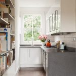 Narrow Kitchen With Huge Vertical Book Rack Grey Kitchen Counter White Cabinet Idea Dark Hardwood Floor Idea