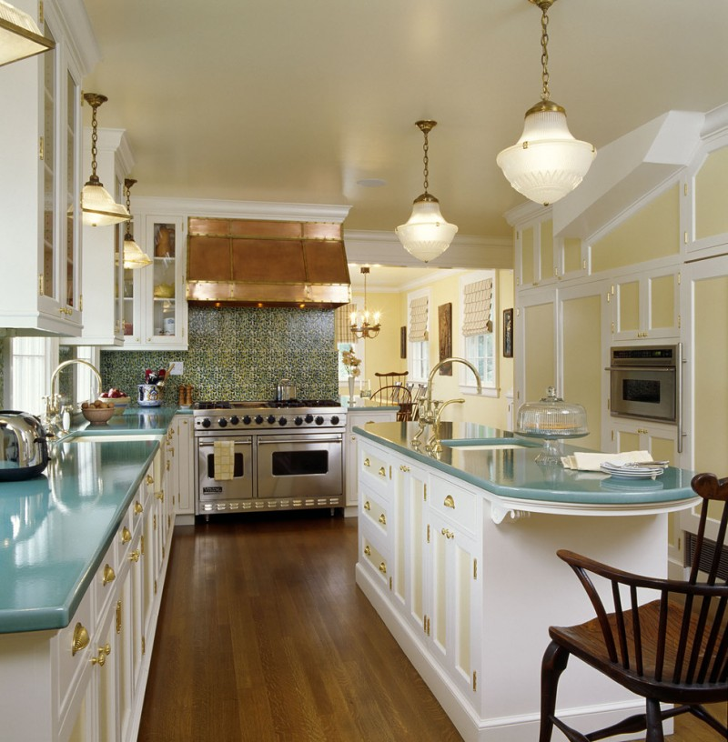 narrow kitchen with turquoise countertop classic pendant lamps turquoise motif backsplash white cabinets with gold scheme handle hardwood floor idea