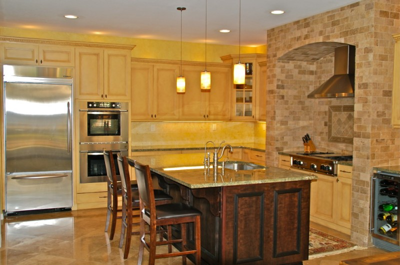 preparation table wiith faucet wall mounted refrigerator modern and stylish pendant lamps huge kitchen cabiinet rustic dining chairs