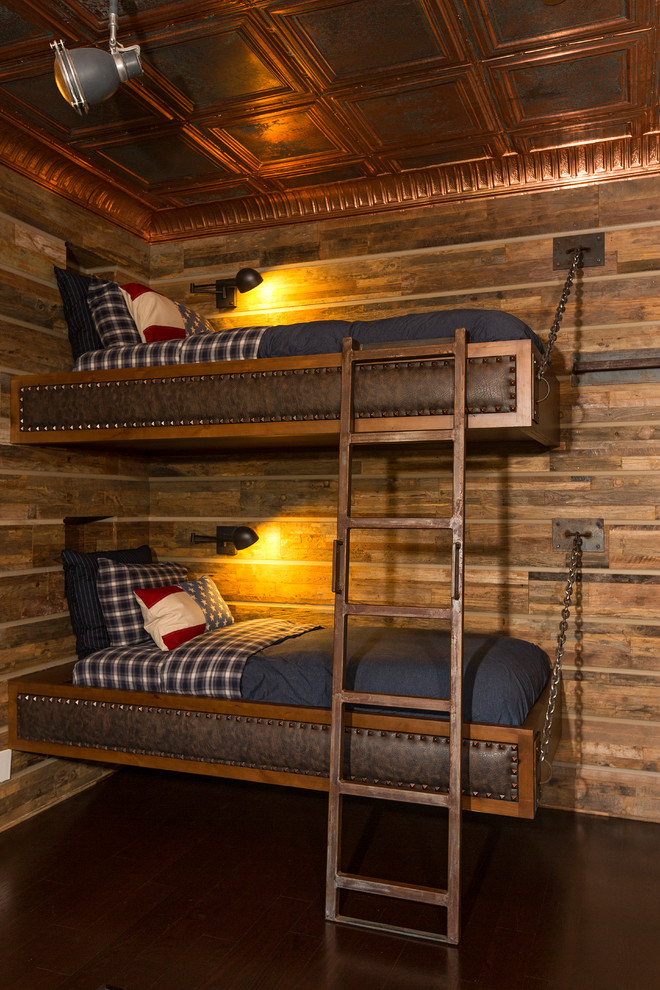 rustic kids' bedroom idea with copper and hardwood finishes upper and lower copper beds with copper ladder copper ceiling dark hardwood floor system rustic wood wall system spot lights