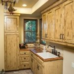 Rustic Laundry Room Idea With Western Style Interior Design Wooden Countertop Wooden Cabinets Brick Floors Recessed Lamps