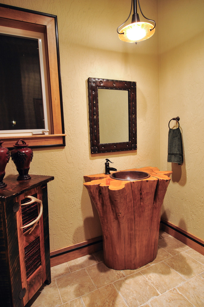 rustic vanity idea in log shape pedestal sink wood top and black finishing vanity mirror