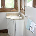Single Corner Bathroom Vanity With Cream Marble Countertop And White Recessed Sink