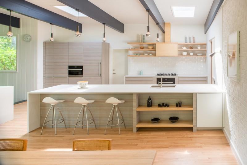 single model open kitchen with wood cabinets modern minimalist white stools white solid breakfast bar white kitchen countertop light wood color kitchen appliances medium size skylight