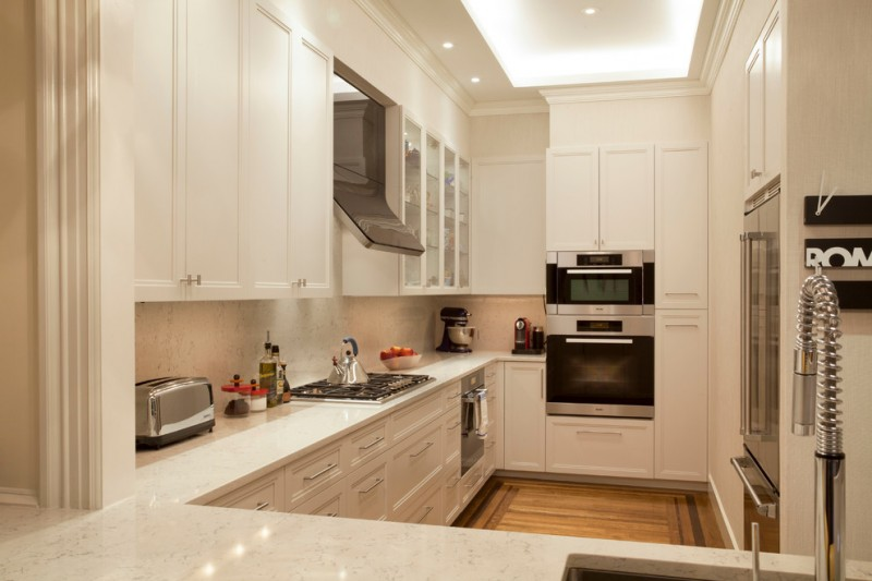 small kitchen in white theme stainless steel appliances wood flooring idea white countertop