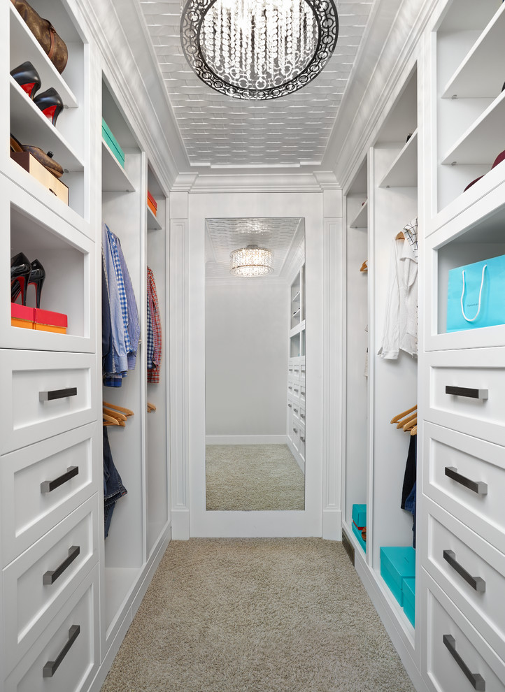 small walk in closet idea with bottom to top mirror luxurious pendant lamps white drawer systems white open shelves white hang sections and additional storage behind the mirror