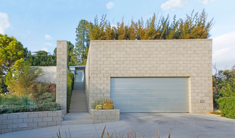 square look grey garage building idea with light metal garaage entrance in grey