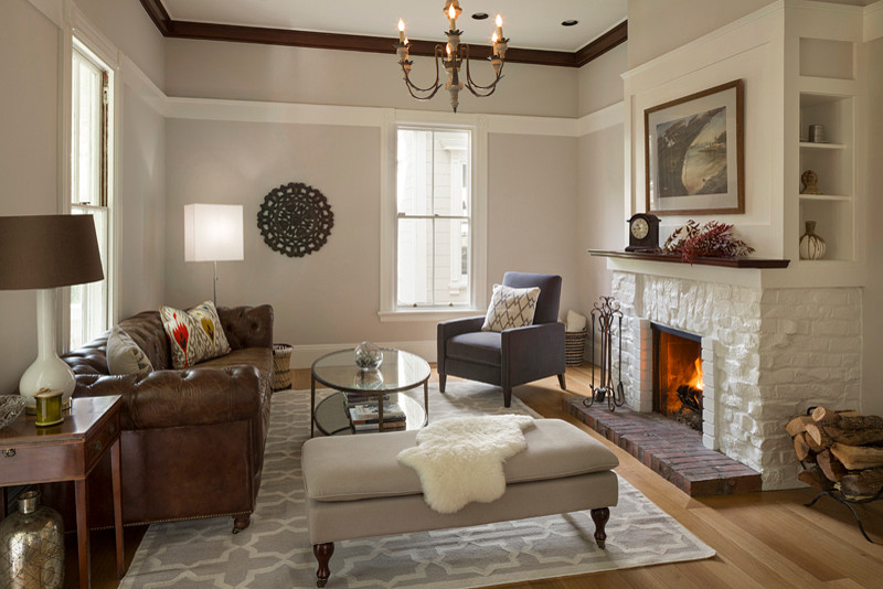 textured white brick fireplace idea in a vintage living room brown leather sofa small and dark grey armchair light grey ottoman chair