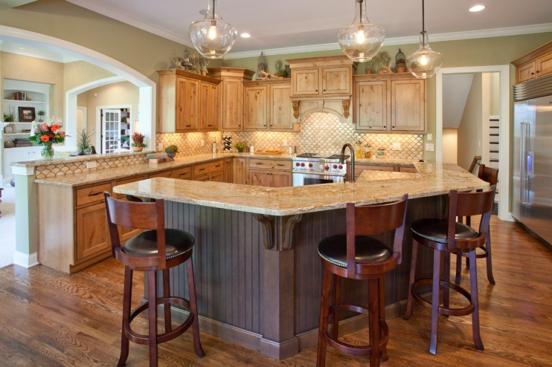 traditional L shaped kitchen counter beige marble countertop wooden  cabinets curve breakfast bar dark finished bar