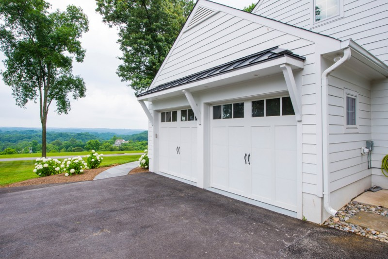 traditional garage design with white garage door