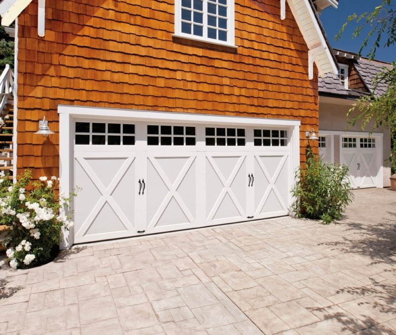 traditional garage with X white garage door