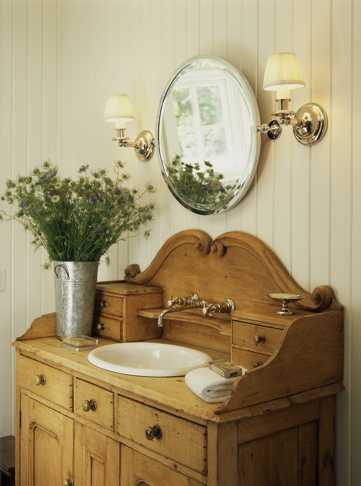 traditional rustic bathroom vanity with single white sink and faucet