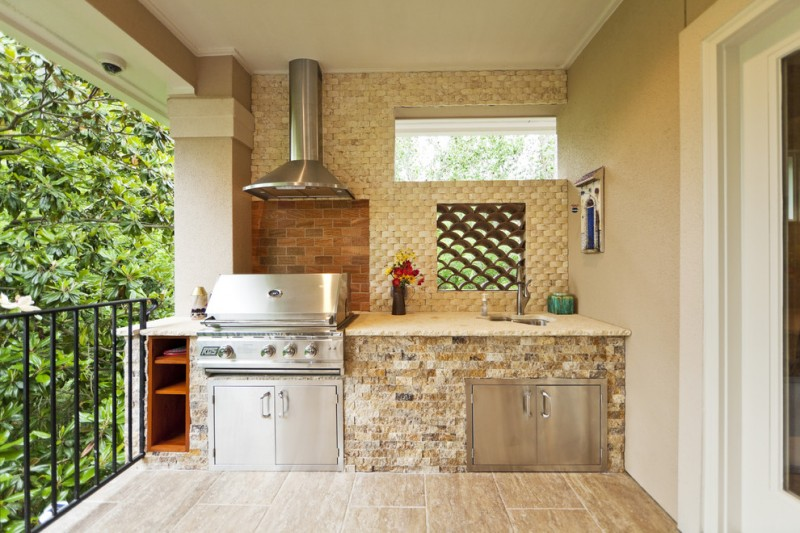 village style outdoor kitchen stainless steel appliances natural stone countertop wooden kitchen cabinets unique kitchen window
