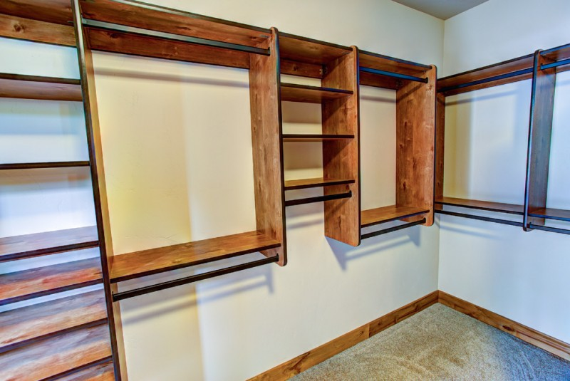 wall mounted rustic walk in closet remodel with hardware support