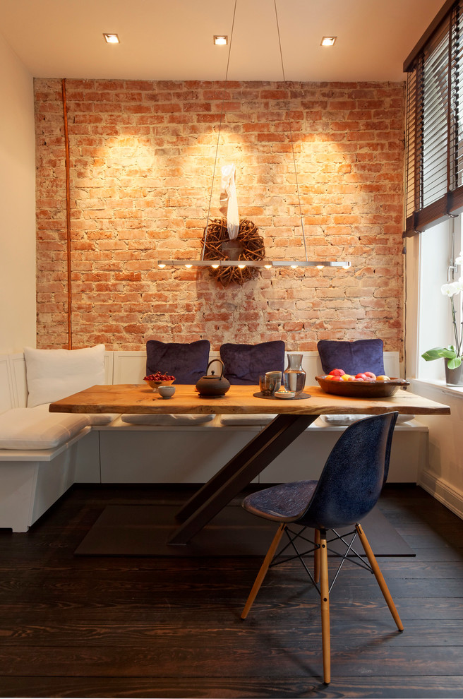 warm and cozy modern dining room with Western value red bricks walls L shaped white dining sofa modern wooden dining table a simple chair dark hardwood floors