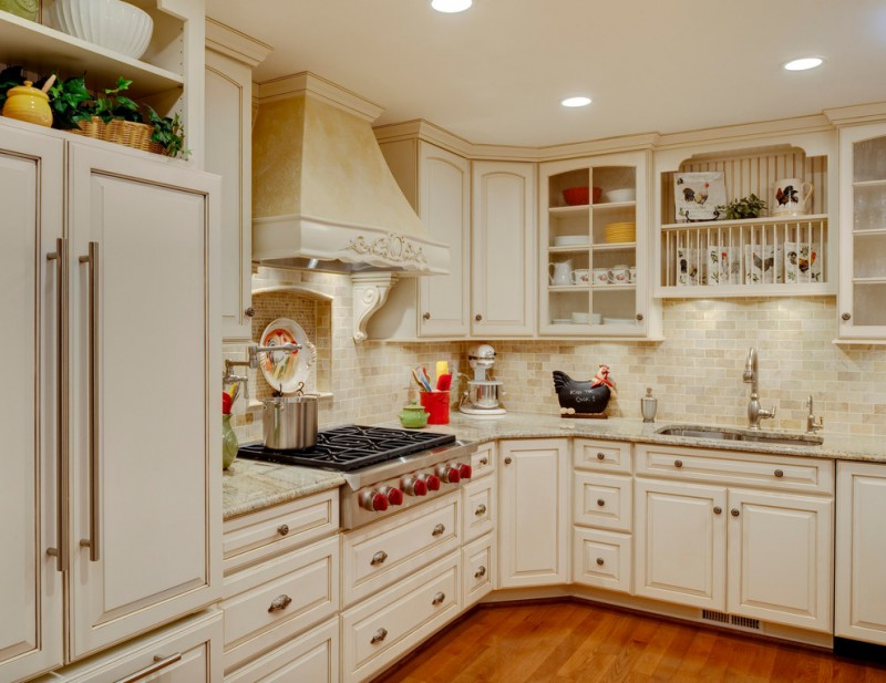 white shabby kitchen design with L shape countertop white shabby subway tiles back splash stainless steel appliances medium tone wood floors white cabinets