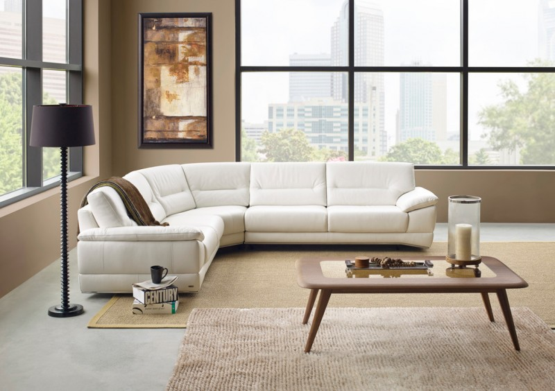 L shaped contemporary sleeper sofa in white wood woven area rugs simple and clean lines wood coffee table black floor lamp