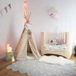 Adorable Nursery Idea Fluffy White Shag Rug In Small Size Grey Rug With White Polka Dots Light Cream Crib Decorative Kids' Tent Medium Toned Wood Floors White Walls