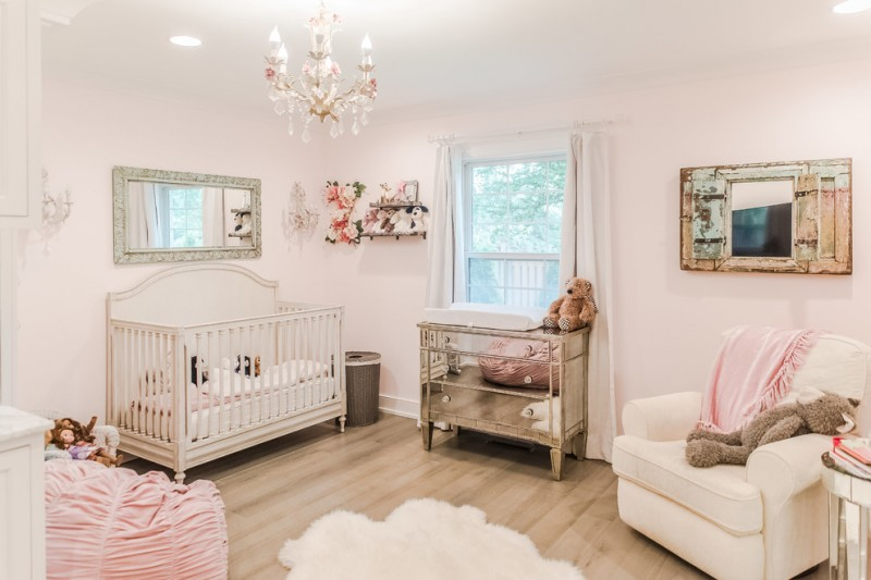 baby girls' nursery room idea baby pink walls baby pink crib traditional dressing white nursery chair small sized and asymmetrical shag rug in white medium toned wood floors