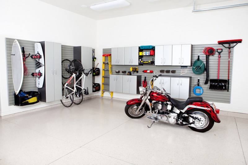 contemporary garage metal cabinets metal hooks metal bins white walls white ceramic tiles floors