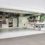 Contemporary Garage Storage Solution With Wall Mounted Bins And Hooks