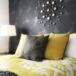 Contemporary Master Bedroom Idea Dark Grey Wallpaper With Lighter Grey Accents Metal Wall Art Mustard Bedding Treatment And Pillows