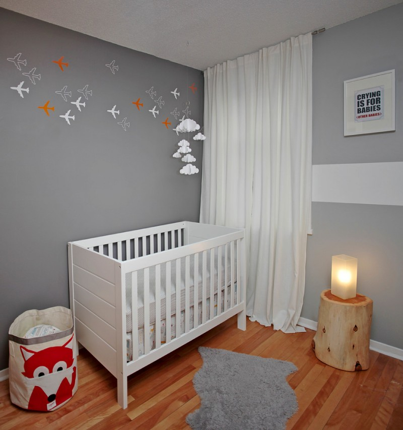 contemporary nursery room in basement grey walls white window curtains log side table with table lamps medium toned wood floors white baby crab