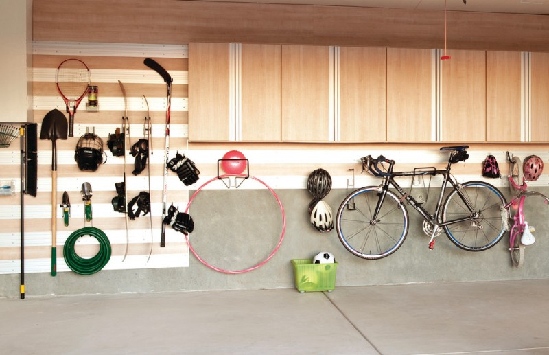 contemporary shed idea light toned wood walls and upper cabinets hooked bike hooked gardening tool hooked sport equipment