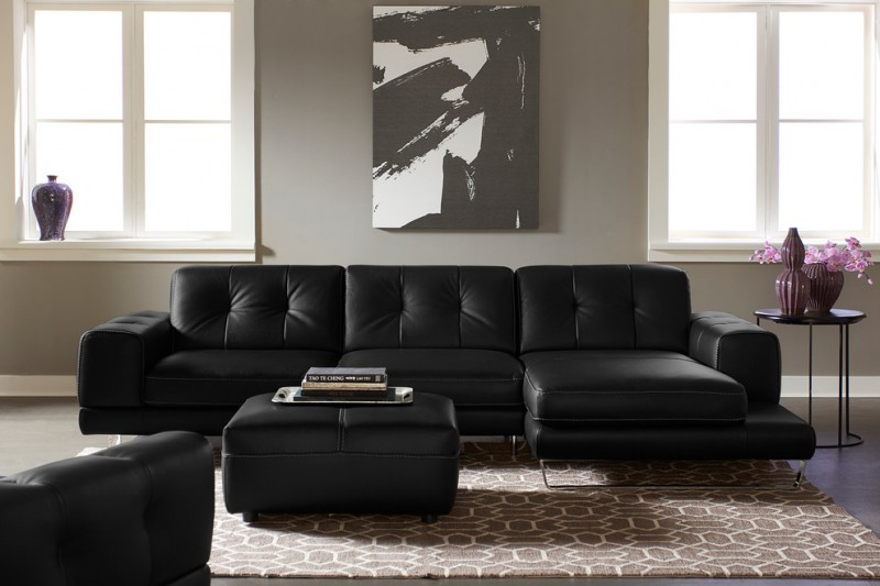 contemporary sleeper sofa with tufted black leather cover black leather coffee table brown area rug with modern motifs black finished side table