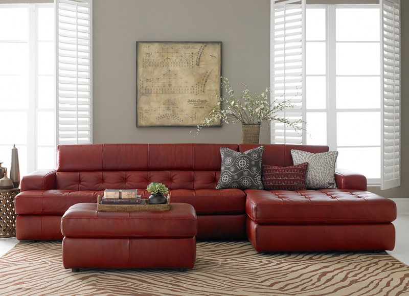 contemporary sleeper sofa with tufted red leather and cushion addition multicolored throw pillows red leather coffee table area rug with simple motifs