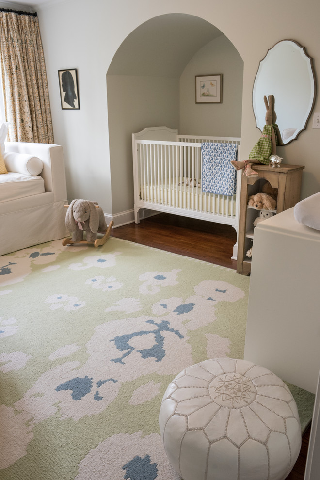 country style nursery idea light green rug with white and blue accents white crib wood animal stuff storage white cotton pouf