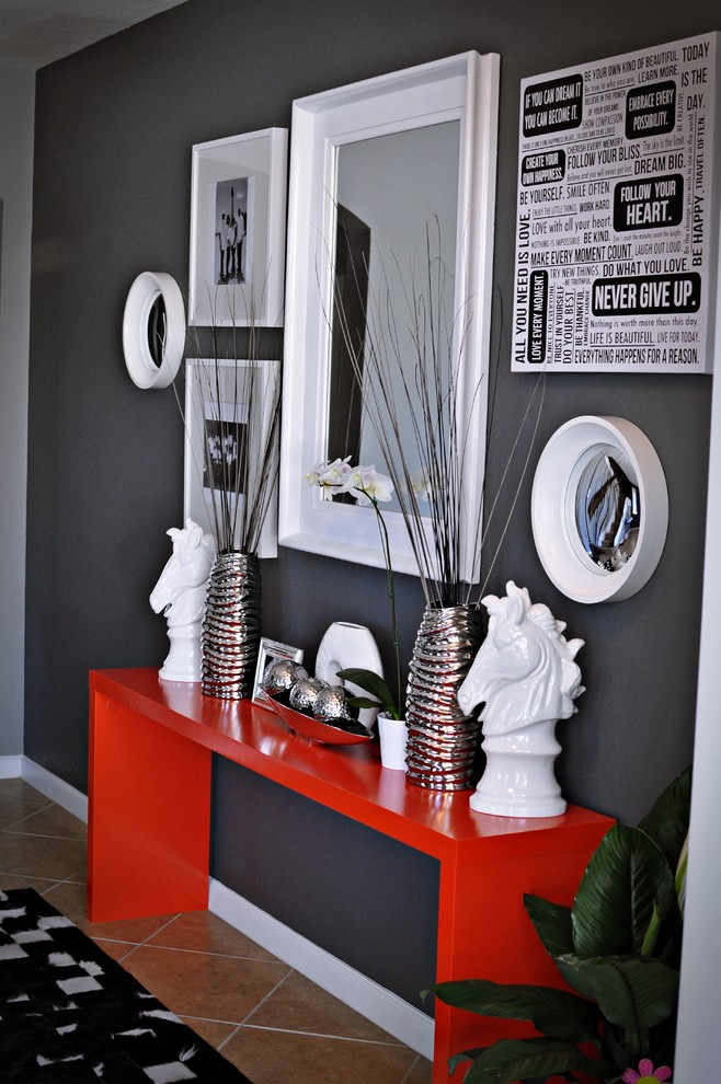 decorative powder table for entryway bold orange dressing table white framed mirror white framed wall decors a couple of white horse head sculptures decorative metal vases