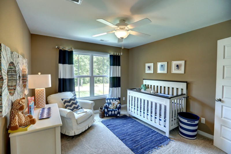 delighted nautical nursery idea bold beige walls white ceilings with conventional ceiling fan black white curtains white nursery chair slipcover bold blue scarf look rug white crib white hall table