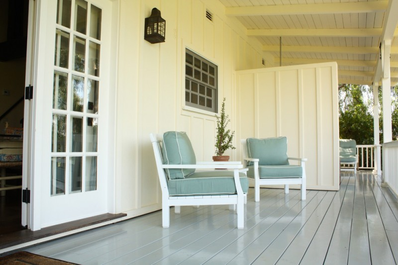 farmhouse front porch idea in small size soft blue chairs with white structure glossy soft blue wood board floors white exterior walls