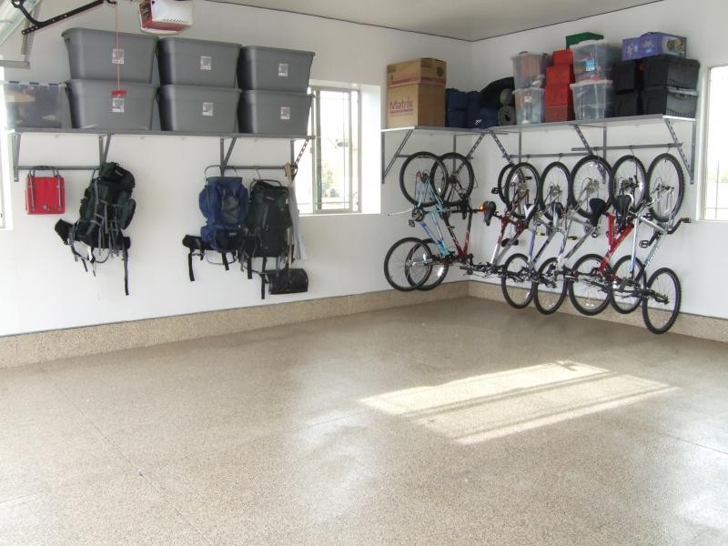 garage storage idea consisting of large wall shelf for containers wall bike racks and holders