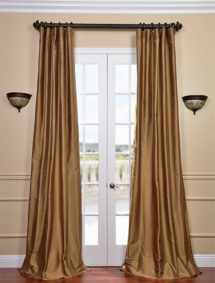 gold toned window curtains for basement light bronze toned walls a couple of wall lamps black wrought iron curtains rod and reels