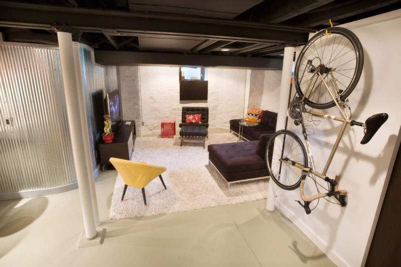 modern basement living room idea modern black sectional modern black media console yellow corner chair in mid century modern style white fury area rug hanging bike rack